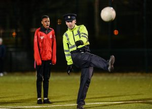 Garda Tommy Carr from Mount Joy Garda Station takes a shot on goal during the late Light League Finals event at the Irishtown Stadium in Dublin